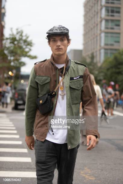 Model Serge Rigvava wears a black newsboy cap green BAPE jacket Chanel crossbody bag after the Monse show during New York Fashion Week Spring/Summer...
