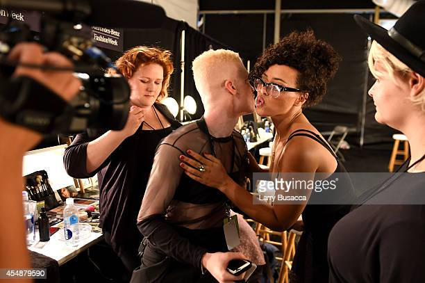 Model Shaun Ross and singer Elle Varner prepare backstage at the Etxeberria fashion show during MercedesBenz Fashion Week Spring 2015 at The Pavilion...