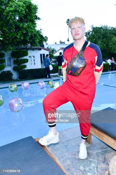Model Shaun Ross poses for a portrait poolside at beGlammed Sunset Soiree Presented by Fullscreen on April 12 2019 in Palm Springs California