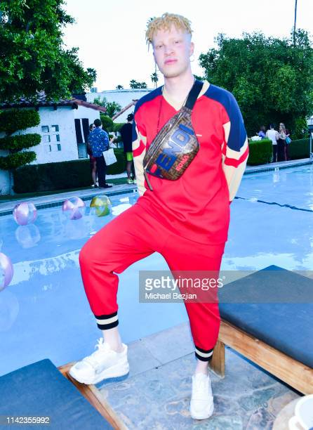 Model Shaun Ross poses for portrait poolside at beGlammed Sunset Soiree Presented by Fullscreen on April 12 2019 in Palm Springs California