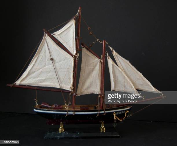 model ship against black background stock images - ship in a bottle stock pictures, royalty-free photos & images