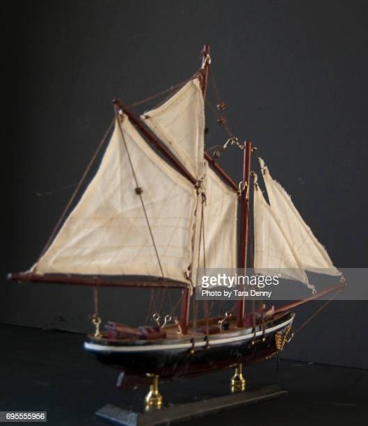Model Ship against black background stock images