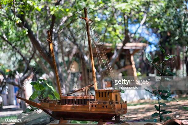 model ship as a decoration piece in the garden. - emreturanphoto stock pictures, royalty-free photos & images
