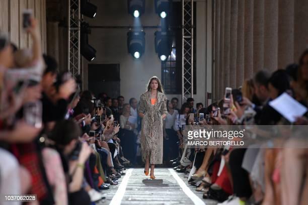 A model shoe detail walks the runway at the Blumarine show during Milan Fashion Week Spring/Summer 2019 on September 21 2018 in Milan Italy