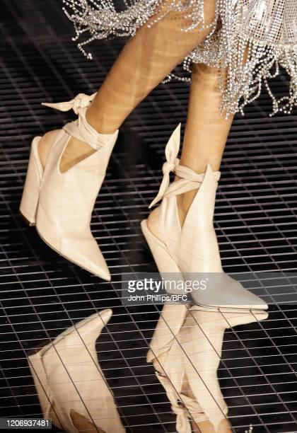 Model, shoe detail, walks the runway at the Burberry show during London Fashion Week February 2020 on February 17, 2020 in London, England.