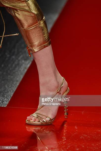 Model, shoe detail, walks the runway at the DSquared2 Ford fashion show during the Milan Men's Fashion Week Spring/Summer 2020 on June 16, 2019 in...