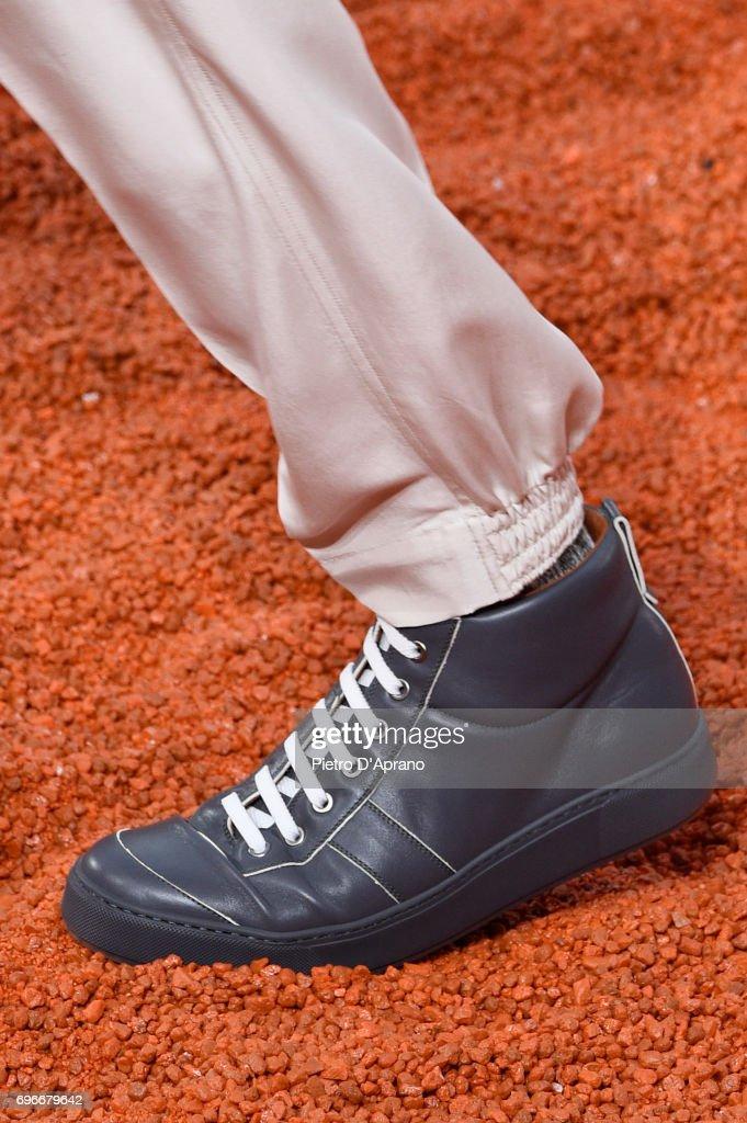 bd5ea2a83a A model, shoe detail, walks the runway at the Ermenegildo Zegna show ...