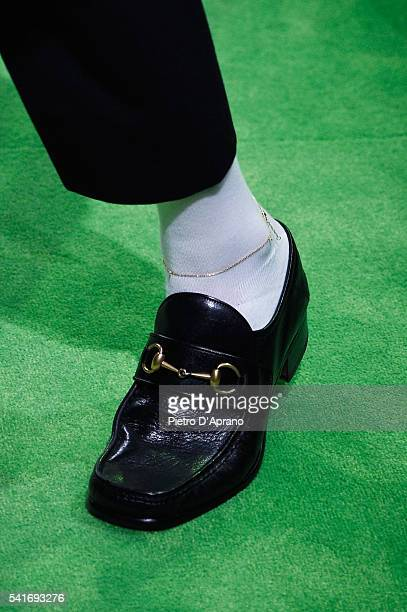 A model shoe detail walks the runway at the Gucci show during Milan Men's Fashion Week Spring/Summer 2017 on June 20 2016 in Milan Italy