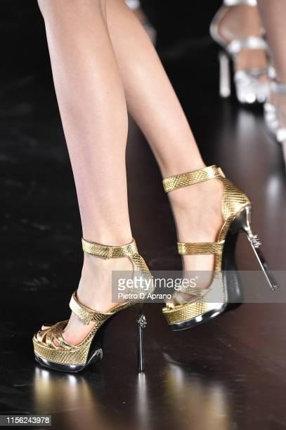 Model, shoe detail, walks the runway at the John Richmond fashion show during the Milan Men's Fashion Week Spring/Summer 2020 on June 16, 2019 in...
