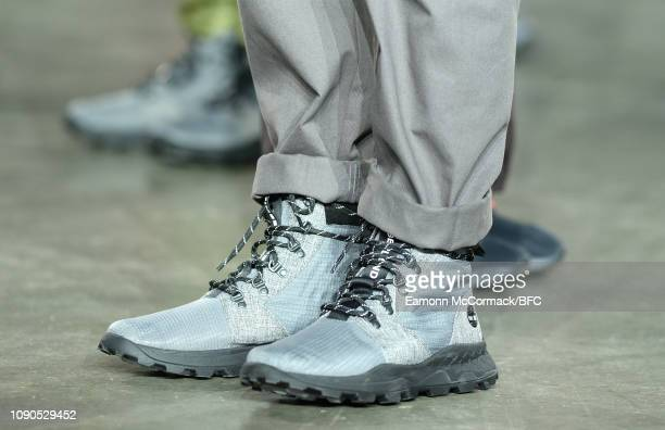 A model shoe detail walks the runway at the RAEBURN show during London Fashion Week Men's January 2019 at the BFC Show Space on January 06 2019 in...