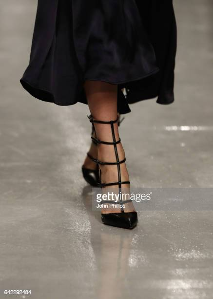 Model, shoe detail, walks the runway at the Teatum Jones show during the London Fashion Week February 2017 collections on February 17, 2017 in...