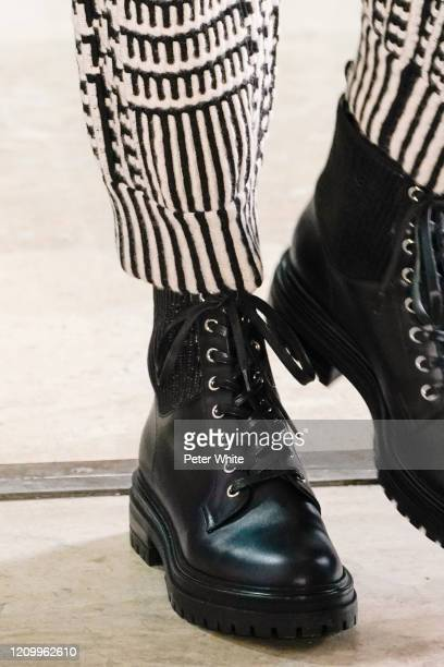 Model, shoe detail, walks the runway during the Akris as part of the Paris Fashion Week Womenswear Fall/Winter 2020/2021 on March 02, 2020 in Paris,...