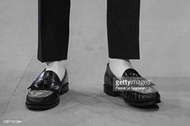 Model, shoe detail, walks the runway during the Celine Menswear Fall/Winter 2019-2020 show as part of Paris Fashion Week on January 20, 2019 in...