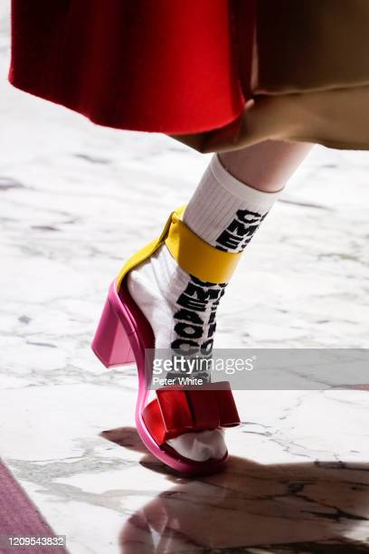 Model, shoe detail, walks the runway during the Comme Des Garcons as part of the Paris Fashion Week Womenswear Fall/Winter 2020/2021 on February 29,...