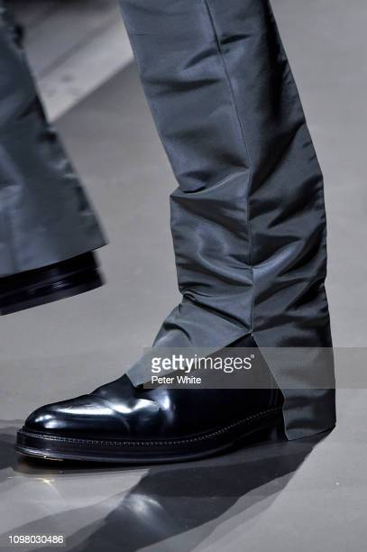 Model, shoe detail, walks the runway during the Dunhill London Menswear Fall/Winter 2019-2020 show as part of Paris Fashion Week on January 20, 2019...