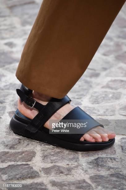Model, shoe detail, walks the runway during the Hermes Menswear Spring Summer 2020 show as part of Paris Fashion Week on June 22, 2019 in Paris,...