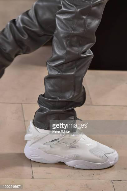Model, shoe detail, walks the runway during the Juun J Menswear Fall/Winter 2020-2021 show as part of Paris Fashion Week on January 17, 2020 in...