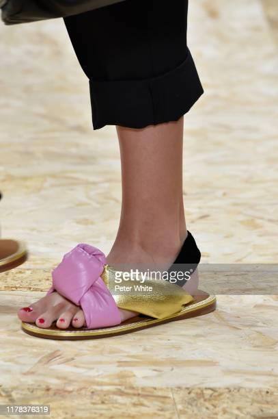 Model, shoe detail, walks the runway during the Miu Miu Womenswear Spring/Summer 2020 show as part of Paris Fashion Week on October 01, 2019 in...