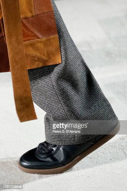 Model, shoe detail, walks the runway during the Tod's fashion show as part of Milan Fashion Week Fall/Winter 2020-2021 on February 21, 2020 in Milan,...