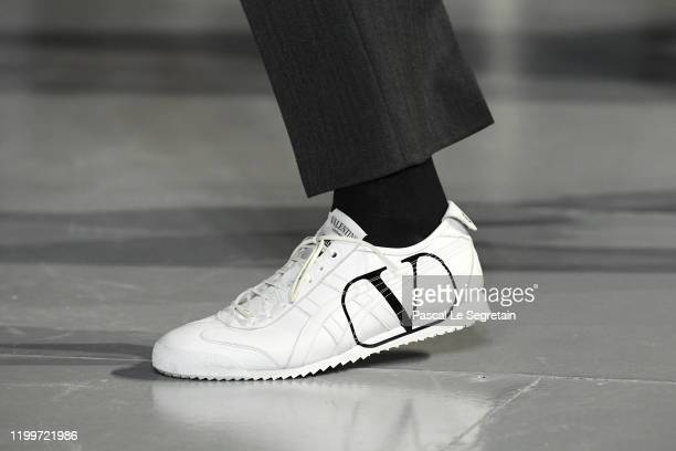 Model, shoe detail, walks the runway during the Valentino Menswear Fall/Winter 2020-2021 show as part of Paris Fashion Week on January 15, 2020 in...