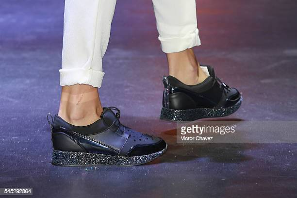 A model shoe detail walks the runway wearing Belinda by Capa de Ozono shoes at Auditorio BlackBerry on July 6 2016 in Mexico City Mexico