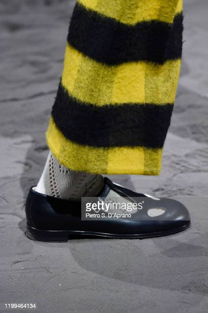 Model, shoe details, walks the runway at the Gucci show during Milan Menswear Fashion Week Fall/Winter 2020/21 on January 14, 2020 in Milan, Italy.
