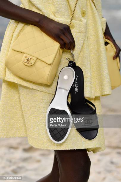 Model, shoes detail, walks the runway during the Chanel show as part of the Paris Fashion Week Womenswear Spring/Summer 2019 on October 2, 2018 in...