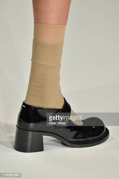 Model, shoes detail, walks the runway during the Maison Margiela show as part of the Paris Fashion Week Womenswear Fall/Winter 2019/2020 on February...