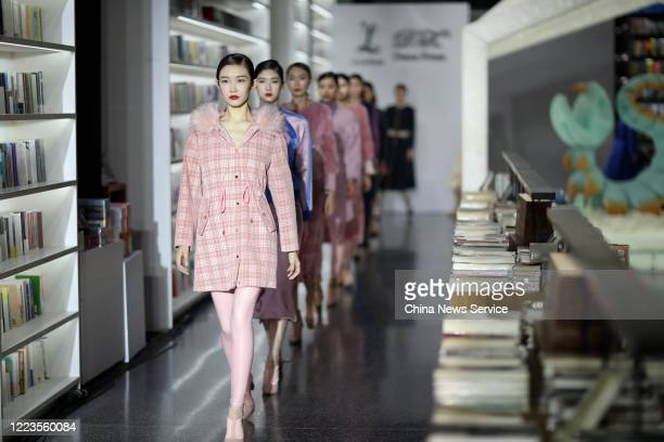 Model showcase designs on runway during the Larome by Yifan Chen DIANA KWAN by Yue Guan collection show on day 7 of the China Fashion Week 2020/2021...