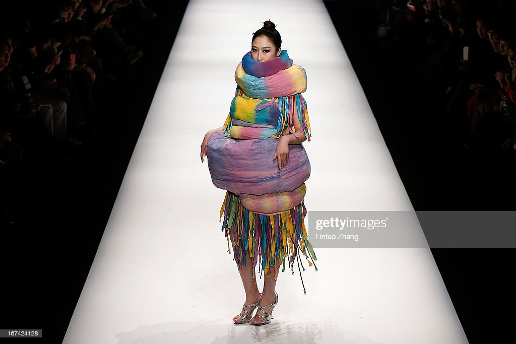 A model showcase designs on the catwalk during the Tianjin Polytechnic University School of Art and Clothing Graduates Show on the second day of China Graduate Fashion Week at 751D.PARK Workshop on April 25, 2013 in Beijing, China.