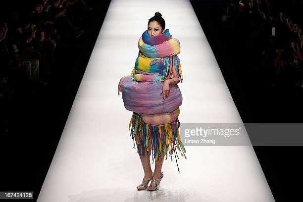 Model showcase designs on the catwalk during the Tianjin Polytechnic University School of Art and Clothing Graduates Show on the second day of China...