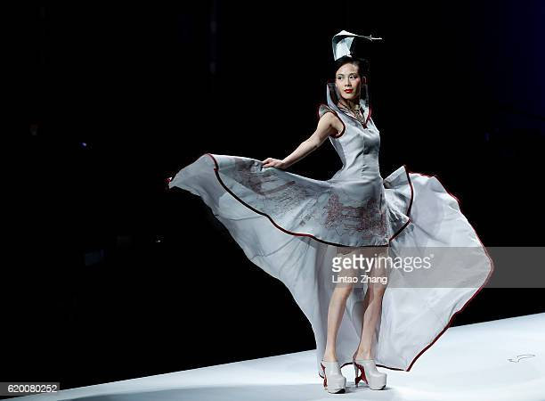 A model showcase designs on the runway during the 95sy Collection by Chinese designer Zhaoping Deng show during MercedesBenz China Fashion Week...
