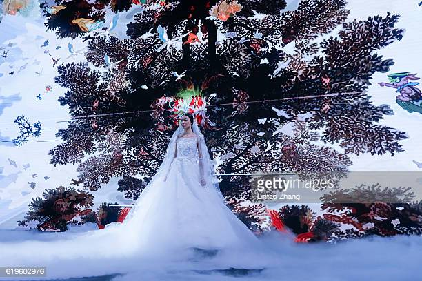 A model showcase designs on the runway during the AMIXAM by Chinese designer Ying Ma show during MercedesBenz China Fashion Week Spring/Summer 2017...