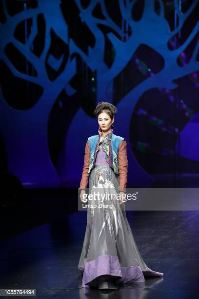 A model showcase designs on the runway during the Creative Rongchang Grass Cloth Collection show by Chinese designer Zhang Yichao in the China...