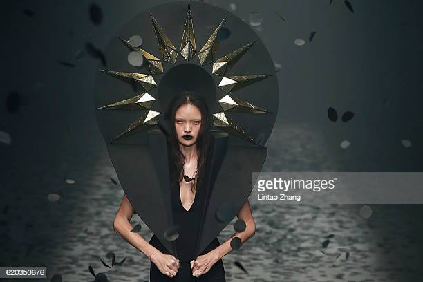 A model showcase designs on the runway during the Gareth Pugh Collection show during MercedesBenz China Fashion Week Spring/Summer 2017 at 751D park...