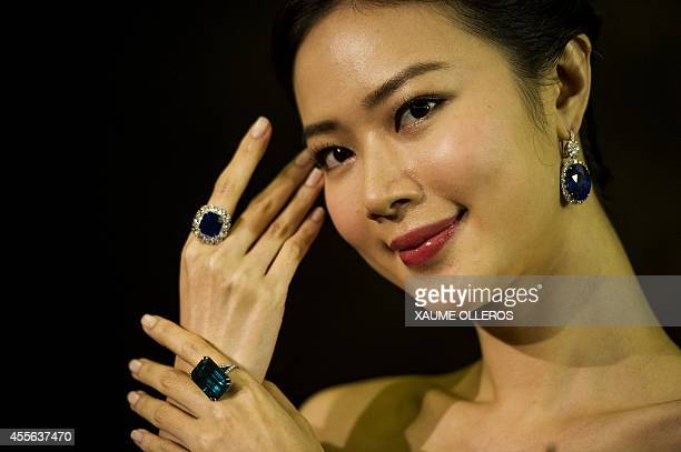 A model showcases a 1716 carat stepcut unheated Kashmir sapphire and diamond Ring a 3572 carat stepcut Colombian emerald and diamond ring at a...