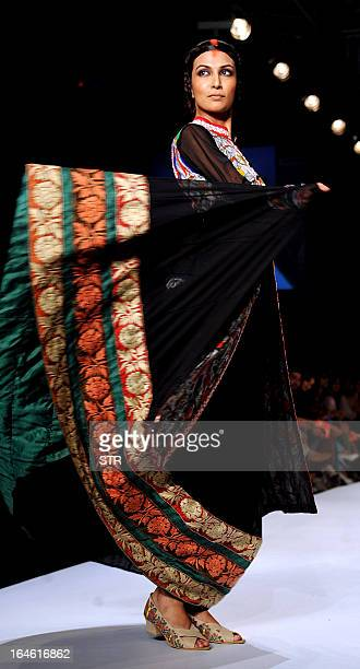 A model showcases a creation by designer Agnimitra Paul during a fashion show on the fourth day of the Lakme Fashion Week summer/resort 2013 in...