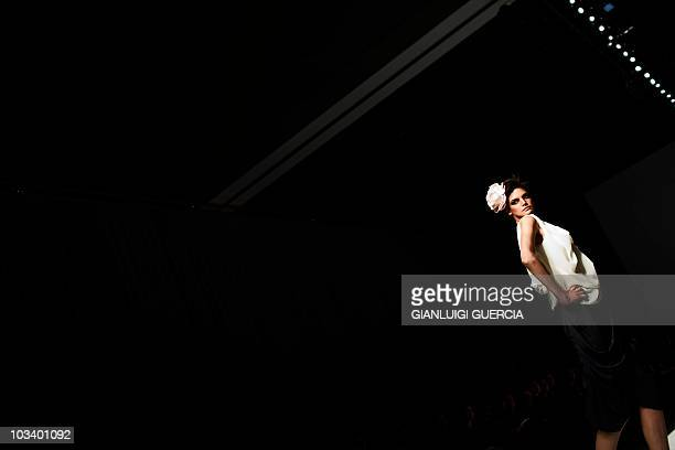 A model showcases a creation by designer 'Michelle Ludek' on August 12 2010 during the Cape Town fashion week at the Cape Town International...