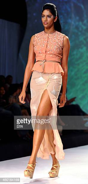 A model showcases a creation by designer Nachiket Barve during the 'Signature Intentional Fashion Week End' in Mumbai on November 16 2013 AFP PHOTO