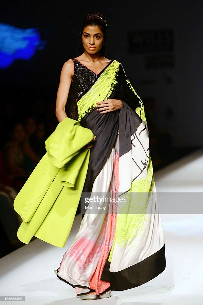 A model showcases a creation by designer Satya Paul at Wills Lifestyle India Fashion Week in New Delhi on March 13, 2013.