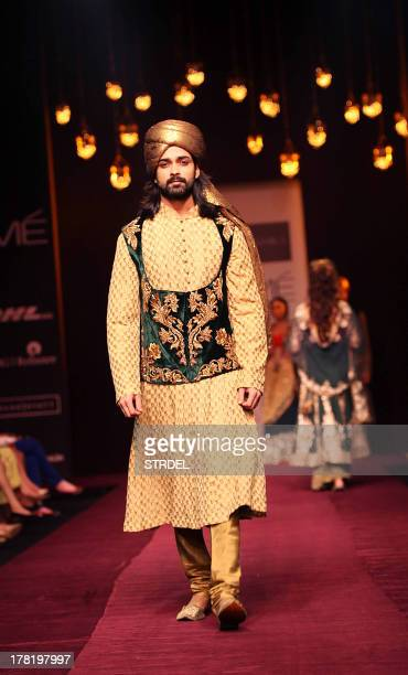 A model showcases a creation by designers Shyaml and Bhumika during the Lakme Fashion Week Winter/Festival 2013 in Mumbai on August 27 2013 AFP...