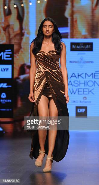 A model showcases a creation by Indian designer designer Monisha Jaising on the fourth day of Lakme Fashion Week Summer/Resort 2016 in Mumbai on...