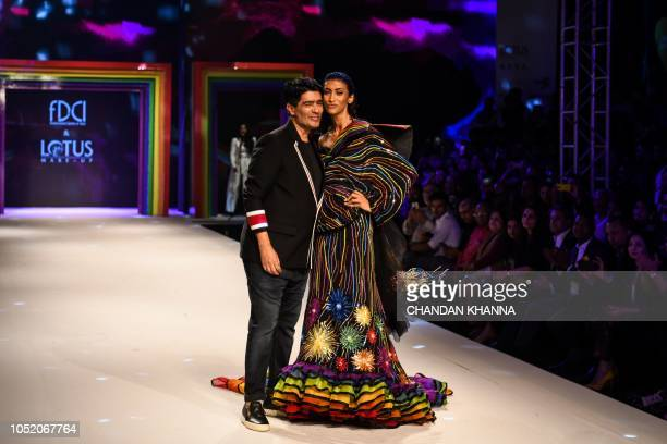 A model showcases a creation by Indian designer Manish Malhotra at the grand finale show based on 'Rainbow' theme in solidarity with the LGBTQ...