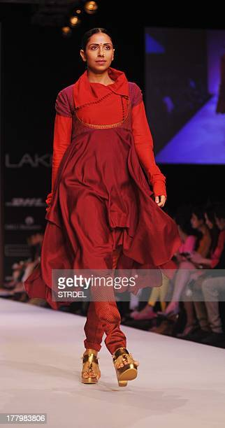 A model showcases a creation designer by Indian designer Shruti Sancheti during the Lakme Fashion Week Winter/Festival 2013 in Mumbai on August 26...