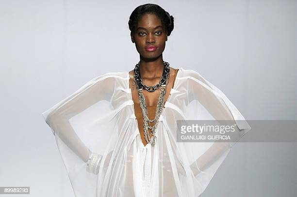 A model showcases a creation from designer David Tlale on August 21 2009 during the Cape Town fashion week at the Cape Town International Convention...