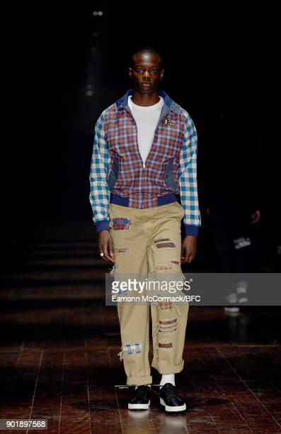 A model showcases a design at the Ben Sherman show during London Fashion Week Men's January 2018 at Embankment Galleries Somerset House on January 6...