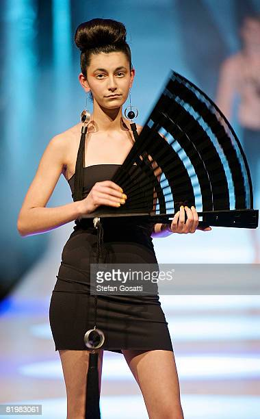 Model showcases a design by Alister Yiap on the catwalk during the StyleAid Perth Fashion Event 2008 at the Burswood Entertainment Complex on July...