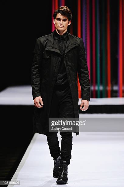 Model showcases a design by Arj Selvam on the catwalk during the StyleAid Perth Fashion Event 2010 at the Burswood Entertainment Complex on July 30,...