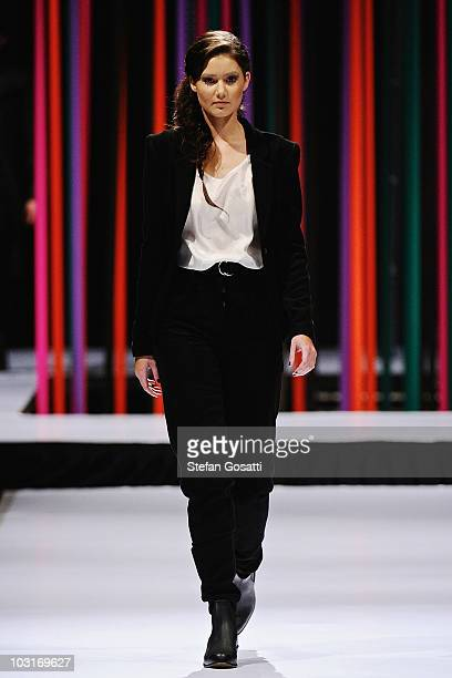 A model showcases a design by Arj Selvam on the catwalk during the StyleAid Perth Fashion Event 2010 at the Burswood Entertainment Complex on July 30...