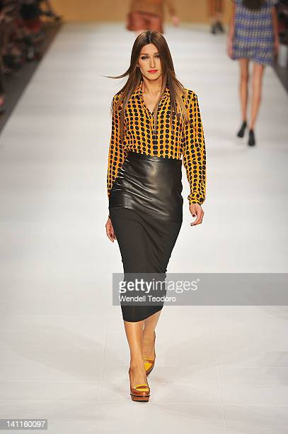 A model showcases a design by Gary Bigeni during the L'Oreal Paris Runway 4 on day five of the 2012 L'Oreal Melbourne Fashion Festival on March 12...